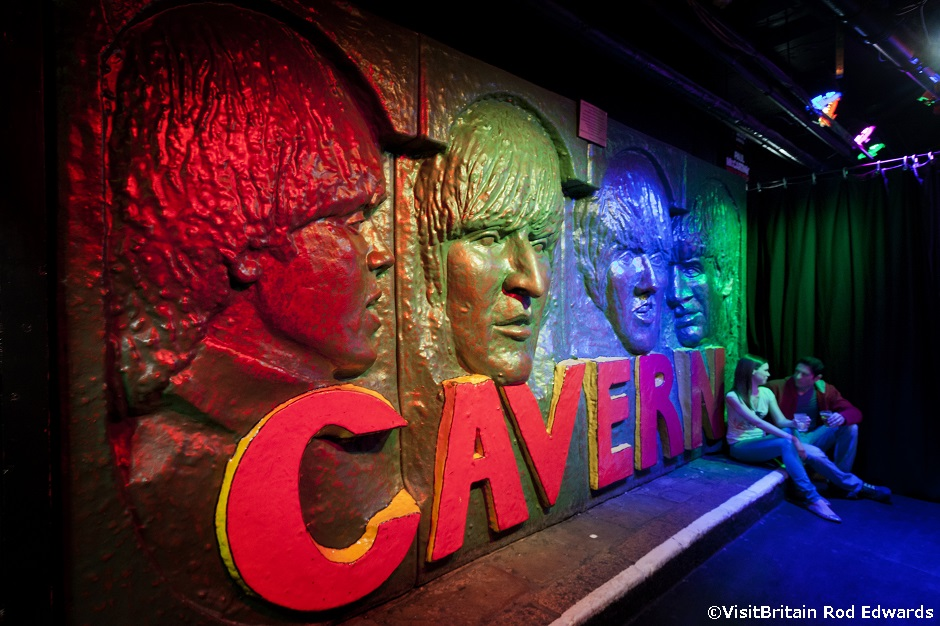 The Cavern Club in Liverpool, the club in Matthew Street where the Beatles music group started their career. The likeness of the four Beatles, John, Paul, George and Ringo on a wall above the entrance.